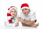 Father And Son In Santa's Hats