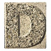 stock photo of carving  - Letter D carved in a concrete block  - JPG