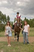 three girls and a horse