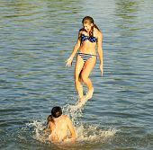 Teenage Girl Jumping Into The River