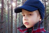 kid boy forest fashion portrait checked coat cap woolen