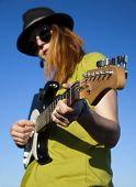 stock photo of minstrel  - Female musician with guitar - JPG