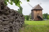Wooden Mill And Braided Fence In The Countryside