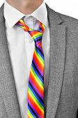 a businessman wearing a rainbow necktie