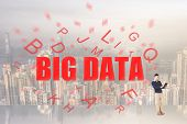 Concept of big data with text come from a man's digital device.