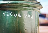 i love you written on street lamp post on a sunny day with a reflective surface