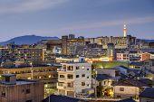 Kyoto, Japan city skyline with apartment buildings.