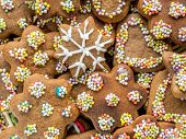 Background of assorted shapes of christmas gingerbread cakes