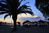 Sunset on the beach of Aegean Sea.