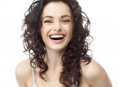 pic of studio shots  - closeup portrait of attractive  caucasian smiling woman brunette isolated on white studio shot lips toothy smile face hair head and shoulders looking at camera tooth - JPG