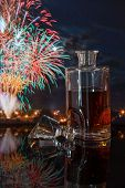 whiskey bottle on a background of fireworks