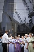 NEW YORK - SEPT 11, 2014: A group of men and women from the Pioneer Valley Mennonite Fellowship sing in front of the Millennium Hilton near the WTC site on the anniversary of the Sept 11th attacks.