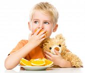 foto of mating bears  - Portrait of a little boy with his teddy bear and oranges - JPG