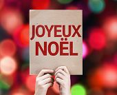 Merry Christmas (In French) card written on colorful background with defocused lights