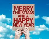 Merry Christmas And a Happy New Year card with sky background