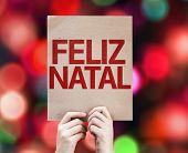 Merry Christmas (In Portuguese) card written on colorful background with defocused lights
