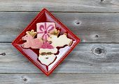 Holiday Cookies In Red Plate On Wood