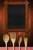 Wooden Blackboard And Kitchen Utensils