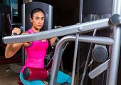 Lat Lateral dorsal pulldown machine upper back exercises woman at gym workout