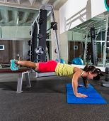 bench push up woman at gym workout exercise