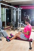 seated cable row man rows at gym low pulley machine workout exercises