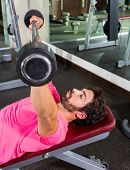 Barbell inclined bench Press flyes man exercise workout at gym