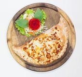 Close Up Italian Pizza Calzone On White Background