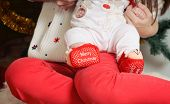 Red Christmas Newborn Baby's Slippers On Cute Little Foots