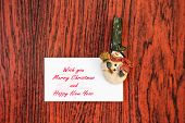 Snowman Clothespins Holding Christmas Greeting Card