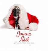 Joyeux noel against vintage mic with santa hat