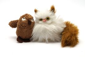 stock photo of nursery rhyme  - Isolated photo of an owl and cat fluffy toy - JPG