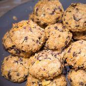 image of baked raisin cookies  - Cookies with raisins on wooden table - JPG