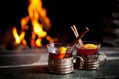 image of cinnamon  - Mulled wine with cinnamon stick by the fireplace - JPG