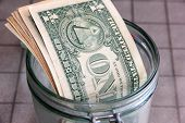 picture of cash  - Small paper dollars in a plastic cash drawer - JPG