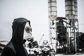 stock photo of gas mask  - Side view of man in protective gas - JPG