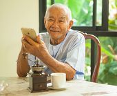picture of older men  - Happy asian senior man using the mobile phone in home - JPG