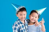 stock photo of birthday hat  - Portrait of Chinese little brothers wearing birthday hats - JPG