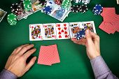 stock photo of gambler  - gambler with chips playing in play poker close up - JPG