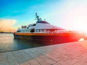 image of hydrofoil  - Ship at the port in the setting sun - JPG