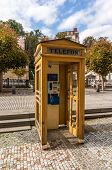 foto of phone-booth  - Yellow Phone Booth In Carlsbad in Czech Republic - JPG