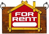 picture of house rent  - Wooden sign with wooden meter ruler in the shape of house with text for rent - JPG