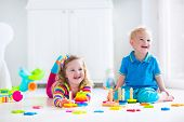 image of kindergarten  - Kids playing with wooden toys - JPG