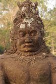 image of serpent  - Stone Asura demons hold the naga serpent king Vasuki on the bridge entrance to Angkor Thom Cambodia - JPG