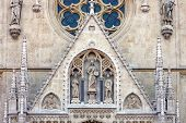 stock photo of blessed  - Gable triangle above the main entrance to the Cathedral of Assumption of the Blessed Virgin Mary in Zagreb Croatia with statue of Christ the Teacher - JPG