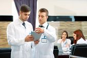 stock photo of training room  - Medical workers working in conference room - JPG
