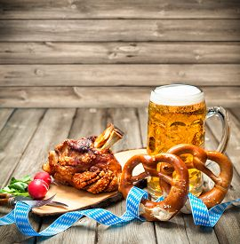picture of pretzels  - Roasted pork knuckle with pretzels and beer - JPG