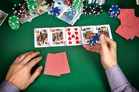 pic of gambler  - gambler with chips playing in play poker close up - JPG