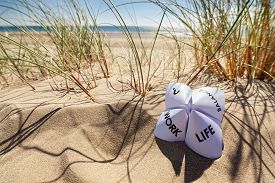 foto of family planning  - Origami fortune teller on vacation at the beach concept for work life balance choices - JPG