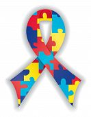 pic of autism  - Smooth satin awareness ribbon in brightly colored puzzle pattern representing support of those with autism and Asperger Syndrome  - JPG