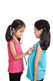 image of identical twin girls  - Happy Asian twins girls with stethoscope isolated on white background  - JPG